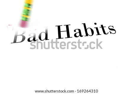 Person using a pencil eraser to erase the bad habits from their life so they can start new - stock photo