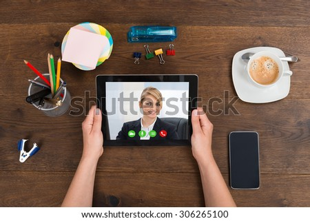 Person Videochatting With Businesswoman On Digital Tablet - stock photo