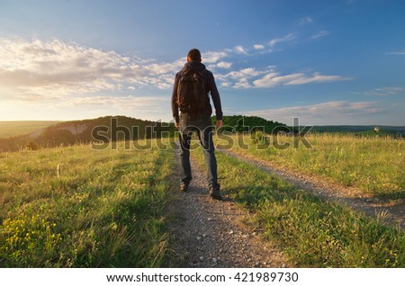 Person walk on the road lane. Traveling and tourist scene. - stock photo
