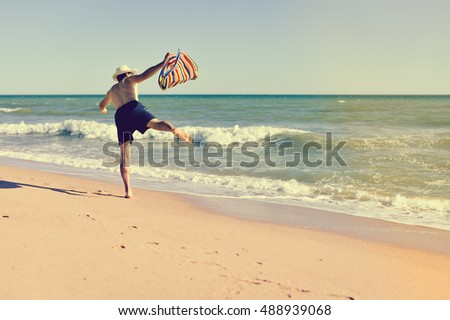 Person walking on summer beach outdoors background