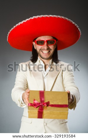 Person wearing sombrero hat in funny concept - stock photo