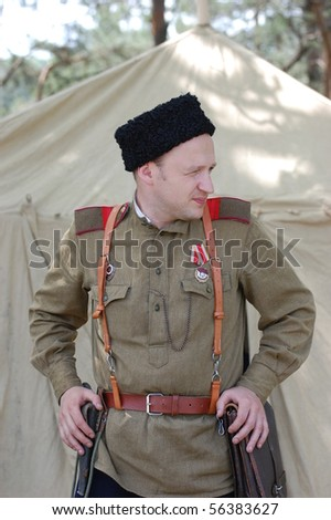 Person wears Soviet military uniform of WW2. Reenactment