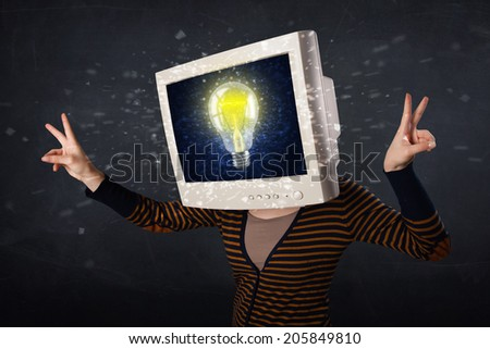 Person with a monitor head and cloud based technology on the screen - stock photo
