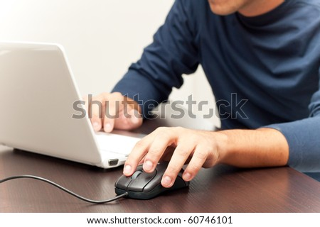 Person working at the notebook - stock photo
