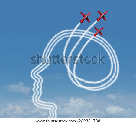 Personal achievement and career aspiration concept as a group of acrobatic jet airplanes performing an air show creating a human head shape for business vision success or learning potential metaphor. - stock photo