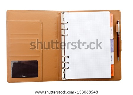 Personal agenda with pen on white isolated background - stock photo