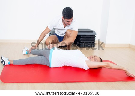 Personal coach correct stretching exercise