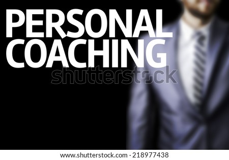 Personal Coaching written on a board with a business man on background - stock photo