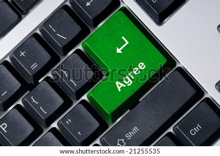 Personal computer keyboard with green key Agree