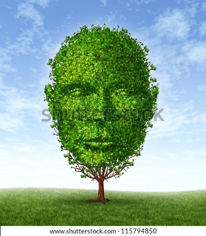 Personal development and personality growth as a medical symbol of psychology as a tree in the shape of a front facing human head as intelligence and social thinking for mental behavior health. - stock photo