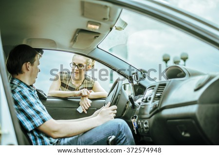 personal driver. A pretty business woman getting into a taxi cab . Skinner wait businesswoman inside luxury car Young adult girl walk outdoor to auto. Empty space for inscription. couple flirting. - stock photo