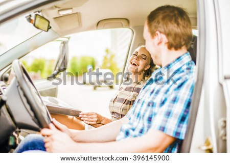 personal driver. A pretty business woman sitting into a taxi cab . Skinner laugh businesswoman inside luxury car. Young adult girl have fan outdoor auto. Empty space for inscription. couple flirting. - stock photo
