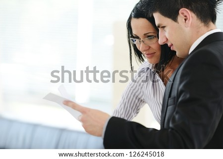 Personal financial adviser using tablet - stock photo