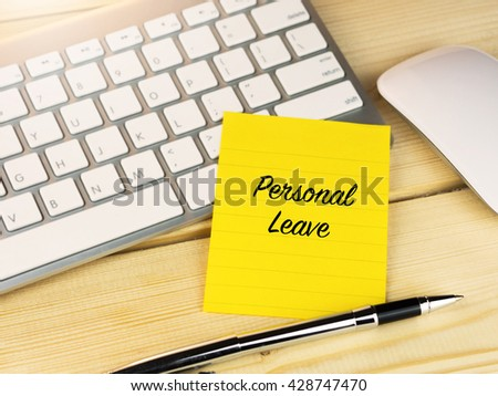 Personal leave on sticky note on work desk  - stock photo