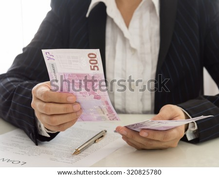 personal loan from a bank employee. finances concept. selective focus. - stock photo