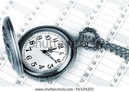 Personal organizer and pocket watch with chain - stock photo