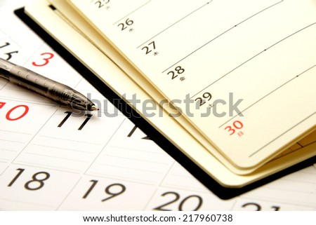 Personal organizer on calender - stock photo