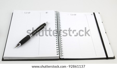 Personal organizer with pen - stock photo