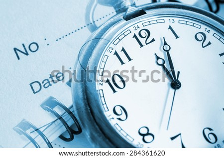 Personal organizer with pocket watch. Business time concept. - stock photo