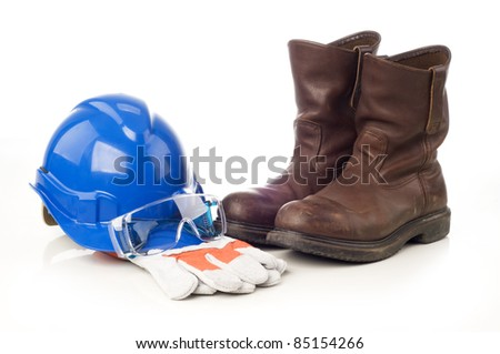Personal Protective Equipment, safety helmet, glove, safety glass and boots isolated white background