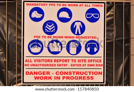 Personal Protective Equipment Sign on a Construction Site - stock photo