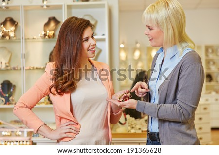 Personal Shopper with woman at jeweler buying jewelry - stock photo