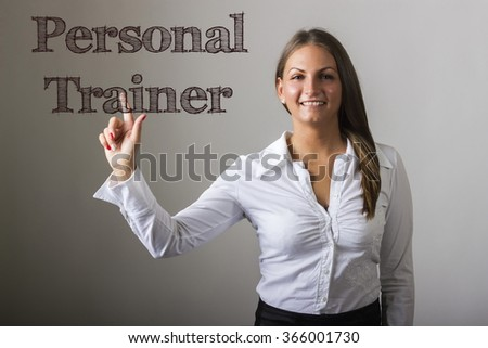 Personal Trainer - Beautiful girl touching text on transparent surface - horizontal image - stock photo