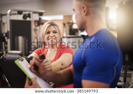 Personal trainer checking recent results
