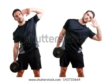 Personal Trainer doing dumbbell side bends for training his abs, isolated in white - stock photo
