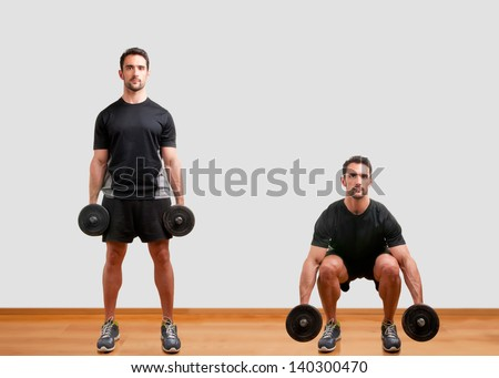 Personal Trainer doing dumbbell squat for training his legs - stock photo