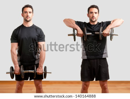 Personal Trainer doing dumbbell upright row for training his deltoids - stock photo