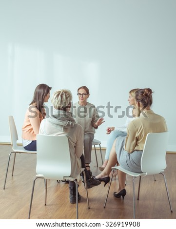 Personal trainer giving extracurricular activities for active women - stock photo