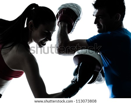 personal trainer man coach and woman exercising boxing silhouette  studio isolated on white background - stock photo