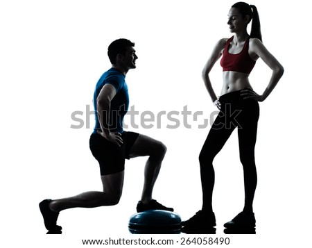 personal trainer man coach and woman exercising squats on bosu silhouette studio isolated on white background - stock photo