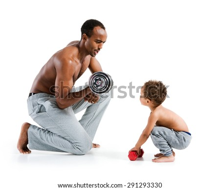 Personal trainer teaches his son how to lift dumbbells correctly / photo set of sporty muscular Hispanic shirtless fitness man with his son over white background