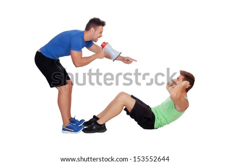 Personal trainer with a megaphone and boy making abdominal isolated on a white background - stock photo