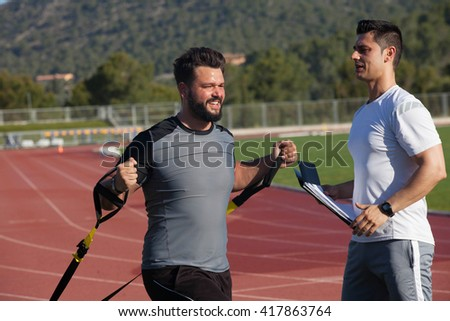 personal trainer workout fitness session - stock photo