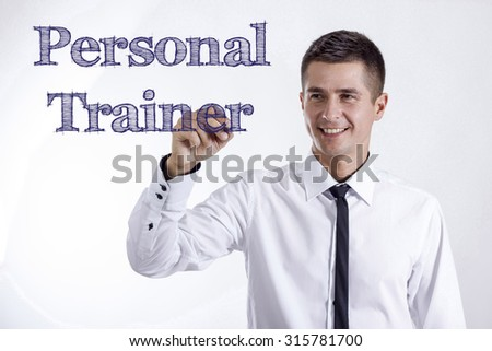 Personal Trainer - Young smiling businessman writing on transparent surface - stock photo