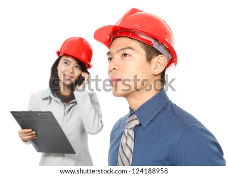 Personnel wearing hardhats and looking up (on white) - stock photo