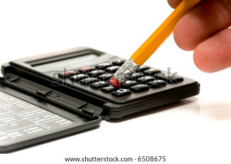 Persons hand holding a pencil using the eraser to punch numbers of a small calculator