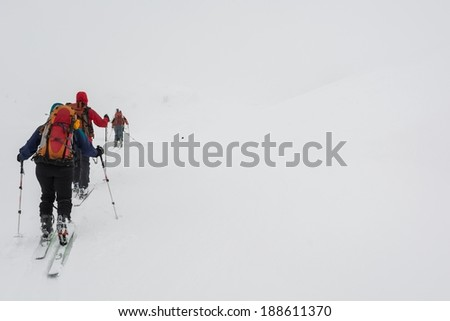 Persons on skies lost in the fog, Slovenia