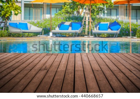 perspective empty wooden terrace with swimmimg pool background usage for montage object