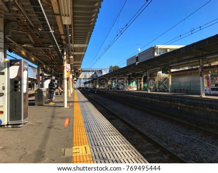Perspective line of Clean train station and clear blue sky at Keisei Narita/Kozu station on quiet Sunday morning ,Chiba Japan 2017