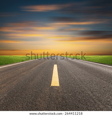 Perspective of asphalt road with evening sky. - stock photo