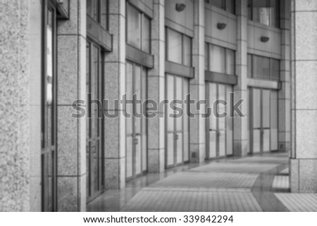 Perspective of corridor at the modern office building - stock photo