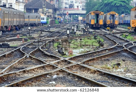 Perspective of crossing railway track junction at Bangkok Station Thailand - stock photo