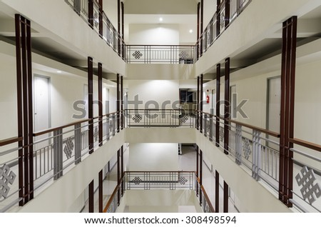 Perspective of long walkway in apartment - stock photo