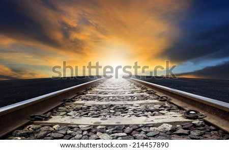 perspective of rail way against beautiful dusky sky use for land transportation and transport industry - stock photo