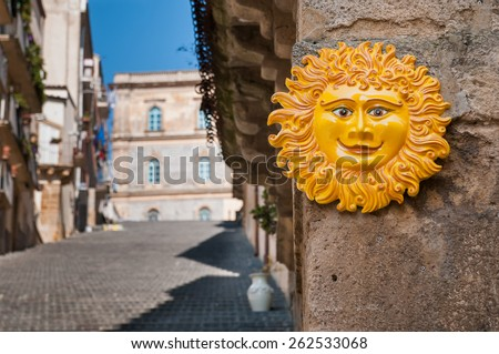 Perspective of the famous Caltagirone staircase with a typical folkloristic ceramic souvenir of the sun on the foreground - stock photo