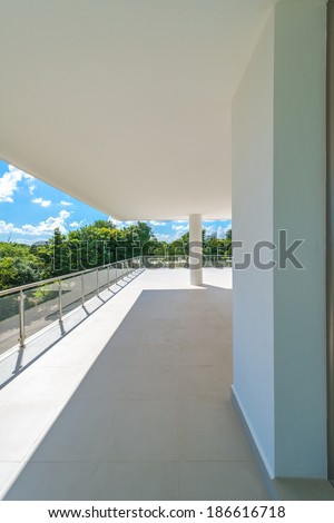 Perspective of the modern glass and steel balcony, deck, patio, promenade railing. Exterior, interior design. Vertical. - stock photo